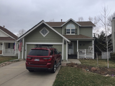 Hail-Damaged Home Updated with Modern Siding and Shingles- Before