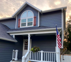Hail-Damaged Home Updated with New, Modern Siding and Shingles